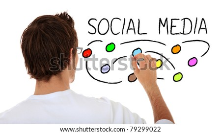 Back view of an attractive young man sketching social media. All on white background. - stock photo