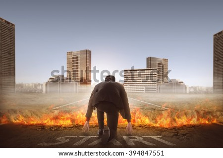 Back view of asian business man start running over broken road with fire - stock photo