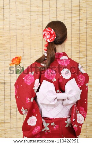Back view of asian woman in traditional clothes of kimono - stock photo
