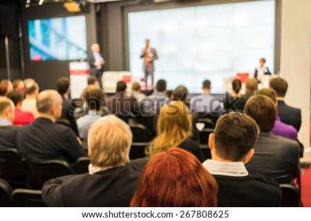 Back view of audience in a business conference - stock photo