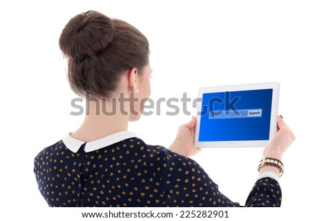 back view of beautiful business woman searching something in internet with tablet pc isolated on white background - stock photo