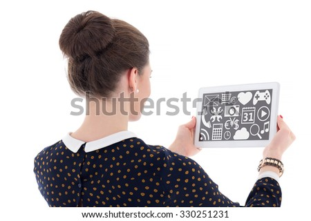 back view of beautiful business woman showing tablet pc with multimedia applications isolated on white background