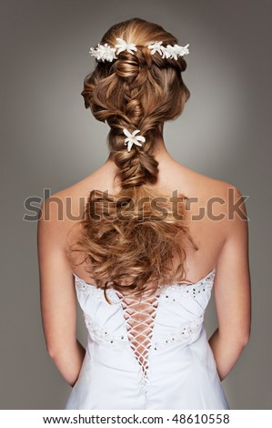 back view of beautiful haircut with small flowers - stock photo