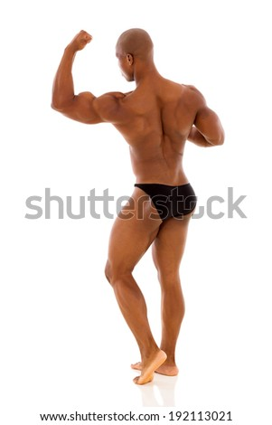 back view of black bodybuilder flexing muscle isolated on white background - stock photo