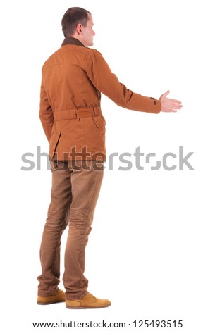 back view of business man in jacket out to shake hands. Rear view people collection. backside view of person. Isolated over white background. - stock photo