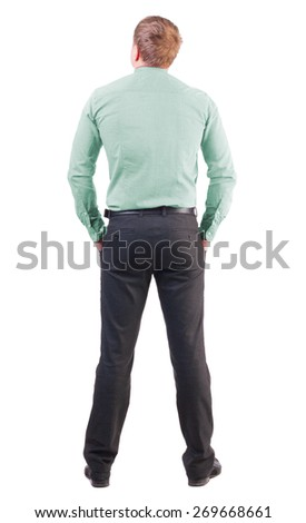back view of business man  in red shirt looks ahead.Rear view people collection.  backside view of person.  Isolated over white background. office worker with a sports figure looks away - stock photo