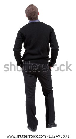 back view of Business man  looks ahead. Young guy in sweater watching.  Rear view people collection.  backside view of person.  Isolated over white background. - stock photo
