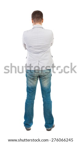 back view of Business man  looks.  Rear view people collection.  backside view of person.  Isolated over white background. A guy in a white jacket folded his arms across his chest. - stock photo