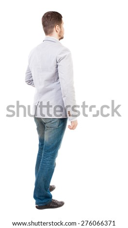 back view of Business man  looks.  Rear view people collection.  backside view of person.  Isolated over white background. A guy in a white jacket standing sideways. - stock photo
