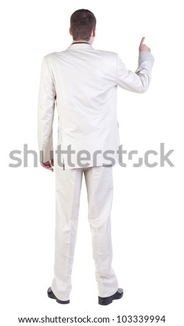 back view of Business man  pointing. Young guy in white suit.   Rear view people collection.  backside view of person.  Isolated over white background.