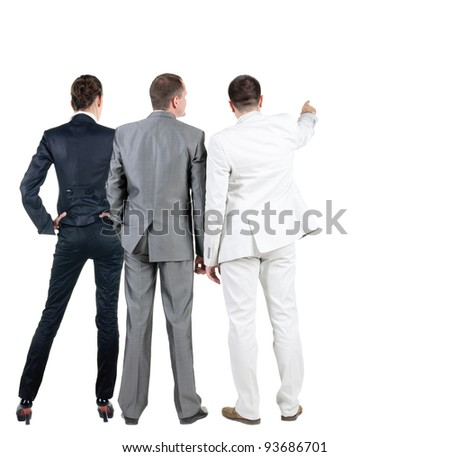 Back view of  business people pointing at wall.  Teamwork of three business people (women and two men) looking at something. Rear view. Isolated over white .
