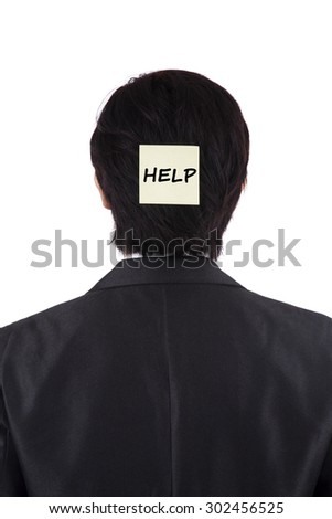 Back view of businessman attached a paper note on his head with a help text - stock photo
