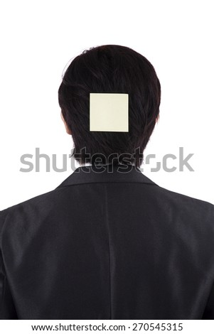 Back view of businessman attaching a blank post it on his head, isolated on white - stock photo