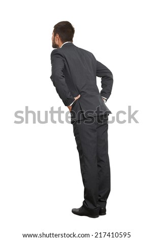 back view of businessman in black suit. isolated on white background