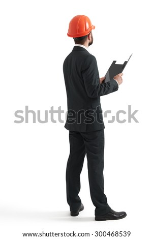 back view of businessman in orange helmet with black folder. isolated on white background - stock photo