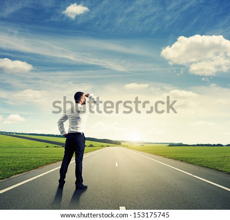 back view of businessman on road - stock photo