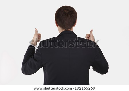 back view of businessman thumbs up - Isolated on white . - stock photo