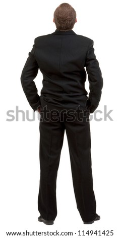 back view of Businessman watching. Young guy in black suit looks ahead.  Rear view people collection.  backside view of person.  Isolated over white background - stock photo