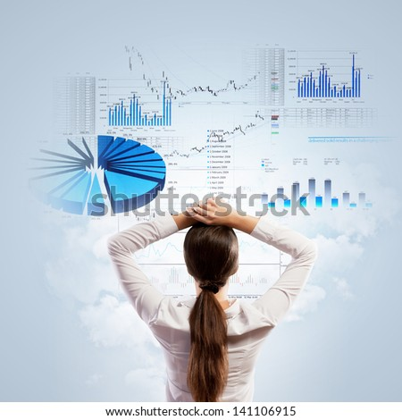 Back view of businesswoman looking at diagram illustration - stock photo