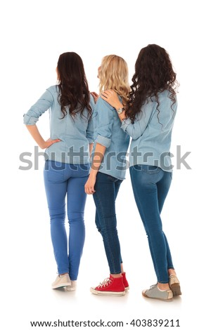 back view of 3 casual women standing in line on white background