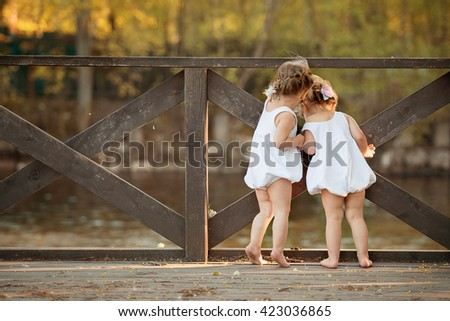 Back view of cute  baby twins girls, happy family - stock photo