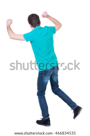 back view of dancing young man. Rear view people collection.  backside view of person.  Isolated over white background. Curly man in a turquoise sweater happily waving his hands.