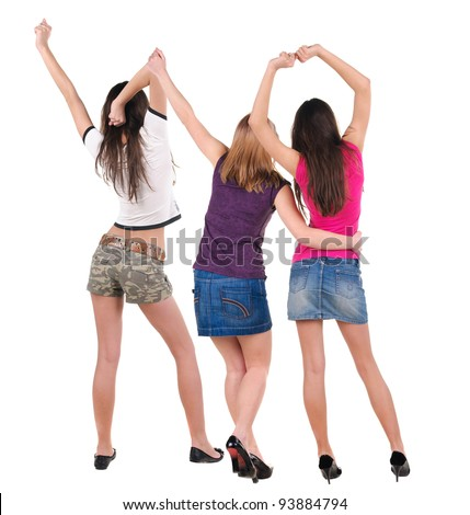 Back view of dancing young women. Dance party. girls dance, enjoy and express positive emotions and having fun.  Rear view. Isolated over white. - stock photo