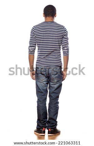 back view of dark-skinned young man in jeans and a blouse - stock photo