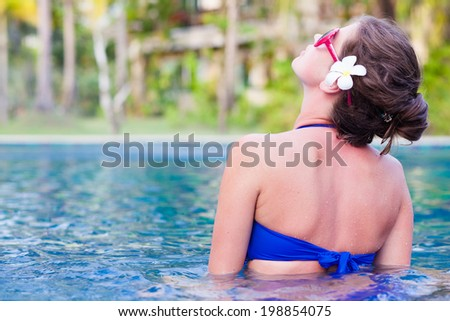 back view of fit woman in luxury spa pool - stock photo