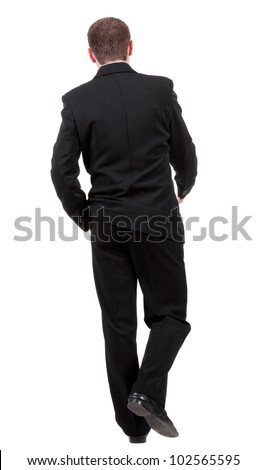 back view of going business man. walking young guy in black suit. Rear view people collection.  backside view of person.  Isolated over white background. - stock photo