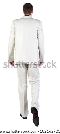 back view of going business man. walking young guy in white suit. Rear view people collection.  backside view of person.  Isolated over white background. - stock photo