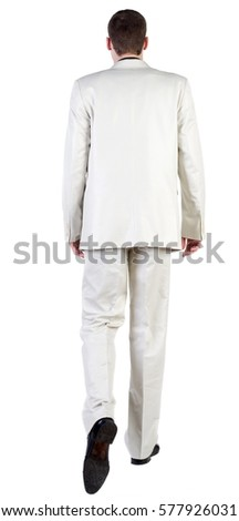 back view of going business man. walking young guy in white suit. Rear view people collection.  backside view of person.  Isolated over white background.