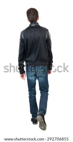 Back view of going  handsome man in jacket.  walking young guy . Rear view people collection.  backside view of person.  Isolated over white background.  The guy is holding up the leg. - stock photo