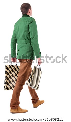Back view of going  handsome man with shopping bags.  walking young guy is shopping. Rear view people collection.  backside view of person.  Isolated over white background. - stock photo