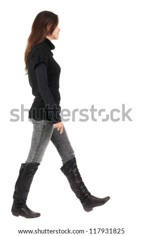 back view of going  woman  in  in jeans and sweater. beautiful brunette girl in motion.  backside view of person.  Rear view people collection. Isolated over white background. - stock photo