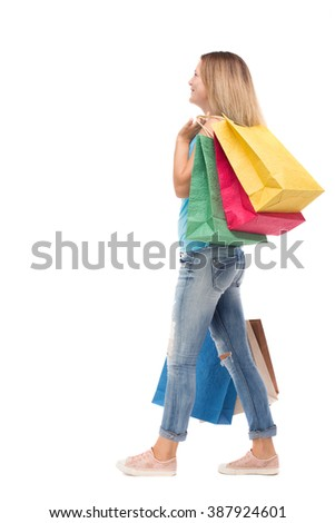back view of going  woman  with shopping bags . beautiful girl in motion.  backside view of person.  Rear view people collection. Isolated over white background. Blonde is thrown behind shopping bags. - stock photo