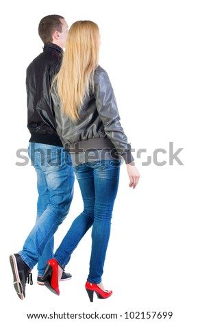 Back view of going young couple (man and woman) . walking friendly girl and guy in jacket and jeans together. Rear view people collection.  backside view of person.  Isolated over white background - stock photo