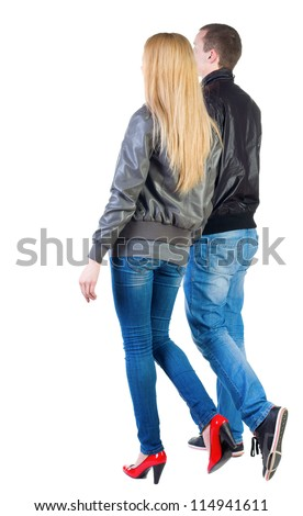 Back view of going young couple (man and woman) . walking girl and guy in jacket and jeans together. Rear view people collection.  backside view of person.  Isolated over white background. - stock photo