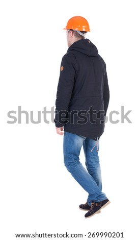 Back view of goingWorker in a helmet. walking young engineer. Rear view people collection.  backside view of person.  Isolated over white background. - stock photo