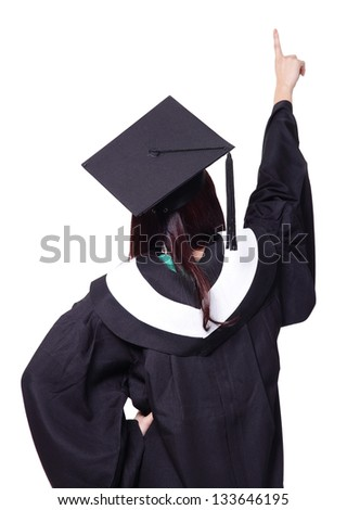 back view of graduate student girl finger point to copy space, she wear graduation cap and gown ,asian woman - stock photo