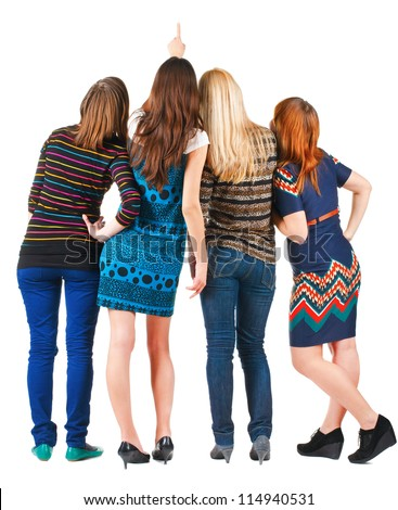 Back view of group beautiful women pointing at wall. Girls team Girl friends looks into the distance. Rear view people. Isolated over white background. - stock photo