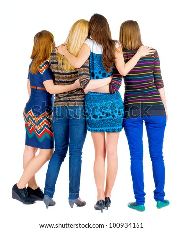 back view of group of young women discussing and watching . girlfriends together. Rear view people collection.  backside view of person. - stock photo
