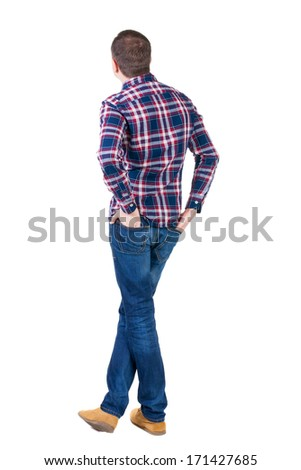 Back view of handsome man in checkered shirt  looking. Standing young guy in jeans. Rear view people collection.  backside view of person.  Isolated over white background. - stock photo