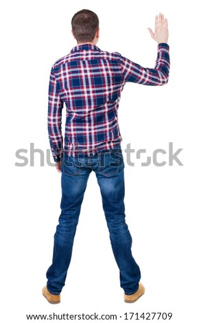 Back view of handsome man in checkered shirt  looking up.   Standing young guy in jeans. Rear view people collection.  backside view of person.  Isolated over white background. - stock photo