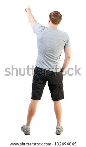 Back view of handsome man in t-shirt and  shorts pointing.   young tourist in summer clothes surprised something. Rear view people collection.  backside view of person.  Isolated over white background - stock photo