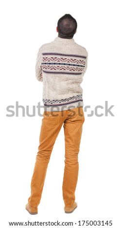 Back view of handsome man in warm sweater looking up. Standing young guy in jeans. Rear view people collection.  backside view of person.  Isolated over white background. - stock photo