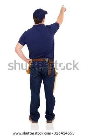 back view of handyman pointing at empty copy space - stock photo
