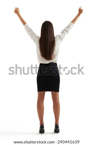 back view of happy businesswoman in formal wear raising her hands up. isolated on white background - stock photo