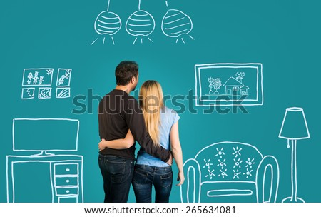 Back view Of Happy Couple Dreaming Of Their New Home And Furnishing On Blue Background. Family With Sketch Drawing Of Their Future Flat Interior. - stock photo