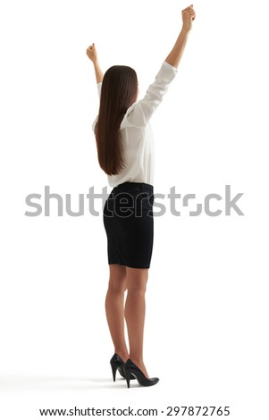 back view of happy winner businesswoman in formal wear raising her hands up. isolated on white background - stock photo